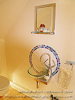 view of shower room with circular backsplash tiles